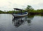 A quiet boat awaits passengers along Lago Verde's coastline.