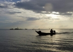 A fisherman returning to his village at sunset along the Rio Tapajós.