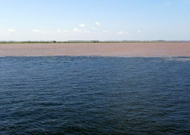 "Meeting of the Waters"": A clear line of demarcation between the blue-brown Rio Tapajós and the muddy Rio Amazonas. The Amazon Basin is full of similar comingling of differently colored waters."