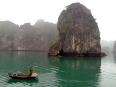 Fisherman working alongside the striking limestone karsts in Lan Ha Bay.