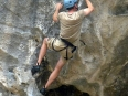 One of the more challenging climbs, here I am beginning the overhang with nothing between me and the coral sand beach 70 feet below