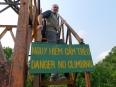 Ignoring the rules, climbing the rusting lookout tower to get above the jungle canopy
