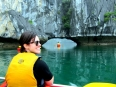 Paddling the natural bridges under the limestone karsts in Lan Ha Bay, Vietnam.
