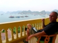 Paul taking in the view from our hotel room balcony in Cat Ba, Vietnam.
