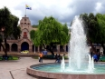 Elegant plazas abound in Cusco, note the rainbow
