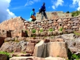 Locals visit the impressive ruins of Pisaq