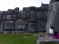 Children playing alongside the massive stone ramparts