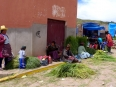 Indigenous women sell produce at the Chinchero market