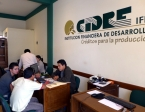 My CIDRE office in the Chimba neighborhood office in Cochabamba.  My co-workers busily getting new clients signed up for a Kiva-funded low interest loan.