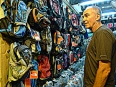 A favorite Paul pastime: shopping for counterfeit The North Face backpacks in Vietnam