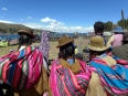 Aymara women watching a bullfight outside Copacabana