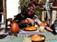 Paul enjoying grilled trout, a Lake Titicaca specialty