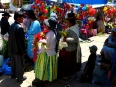 Aymara women selling vehicular adornments for the ritualized blessing at the Basilica of Our Lady of Copacabana