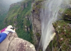 The waters of Cachoeira da Fumaça barely descend before being blown back over the top in a misty cloud.