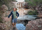 At a decent waterfall on the road to the Cachoeira da Fumaça trailhead.