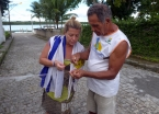 Rosita getting a lesson in fishing net repair from a local on Tinharé Island