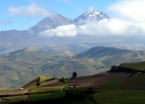 The double peak of Los Illinizas volcanoes soaring above the Andean valley