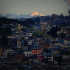 One of the sunset-lit volcanoes towering above Quito's Old Town
