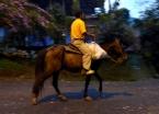 Early morning rider through the dark streets of San Andrés de Pisimbala