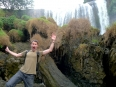 Slippery When Wet! Losing my balance in front of one of the many gushing waterfalls in Vietnam's Central Highlands