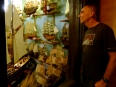 Admiring the hand-crafted wooden ships in a shop in Hoi An, Vietnam