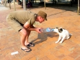 "Playing ""it's mine"" with a furry friend at the beach near Hoi An"