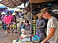 Bargaining for a knife in Hoi An, needed for peeling the delicious tropical fruits found in Vietnam
