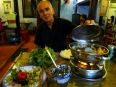Paul showing off the veggie hot pot at the Lien Hoa restaurant in Hué, perhaps our tastiest meal in all of Vietnam