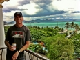 Paul with a cold can of Bia Ba Ba Ba (333 Beer) on our balcony in Nha Trang with sweeping views of the South China Sea