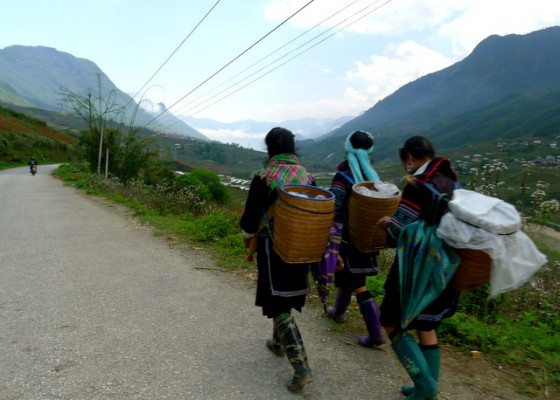 H'Mong hill-tribe people walking the road to their villages