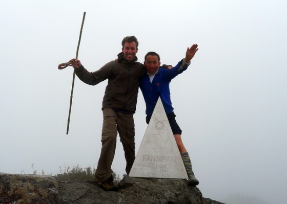 Celebratory photo atop Mt. Fansipan with my hardy H'Mong guide Mi-to-sa