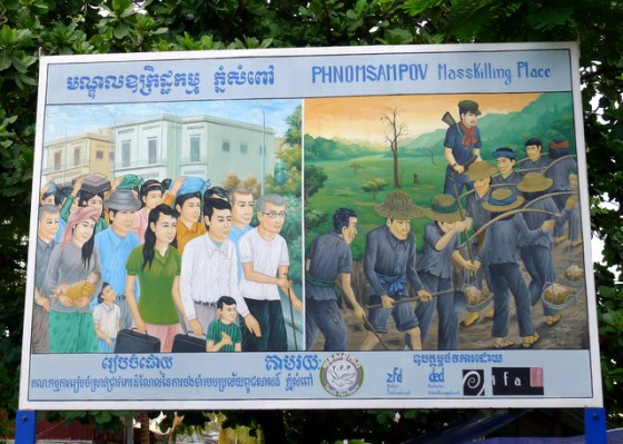 Billboard at a mass killing location outside of Battambang, Cambodia documenting the expulsion of people from cities to work on forced-labor camps in the countryside