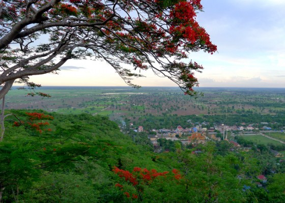 Views from Phnom Sampeau, aka the Killing Cave near Battambang.  Note the red fire trees in bloom and the rice paddies starting t