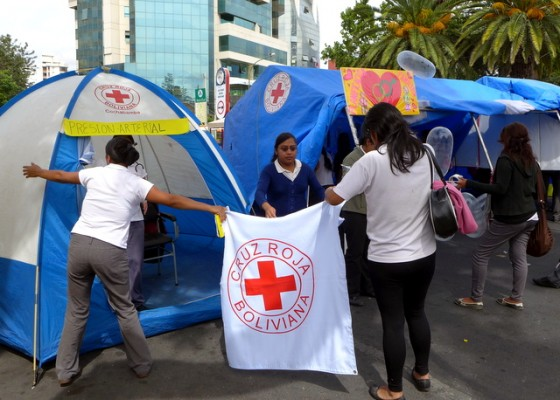 Lots of community organizations and groups set up in the streets. Here the Red Cross sets up a mobile wellness (and condom distribution) center.