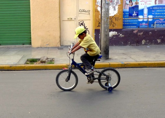 Pedal-powered vehicles aren't limited to two wheels on Pedestrian Day... ¡ándate pues, niño!