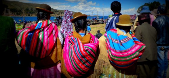 Chola women watching a bullfight in the altiplano