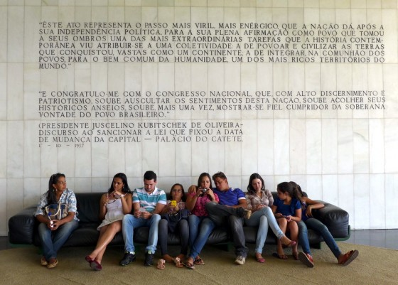 Brazilians beneath beloved President Juscelino Kubitschek's loquacious dedication of the city of Brasília.